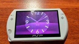 Игровые приставки - PSP go, 0