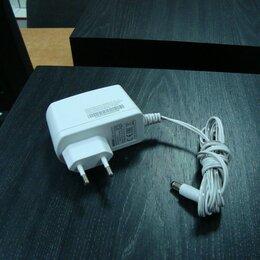Зарядные устройства и адаптеры питания - Блок питания 12V на 2A новый, 0