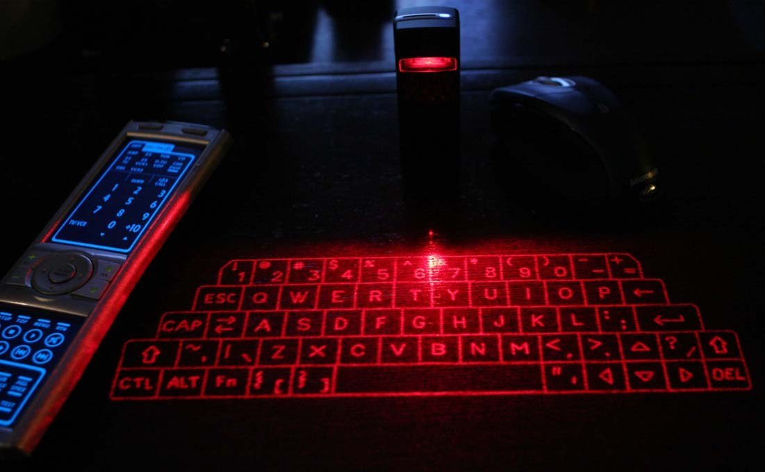 projected keyboard A projection keyboard unit generally includes a laser to project a visible virtual keyboard onto a surface (eg, a red diode laser as a light source to project a full size qwerty layout keyboard.