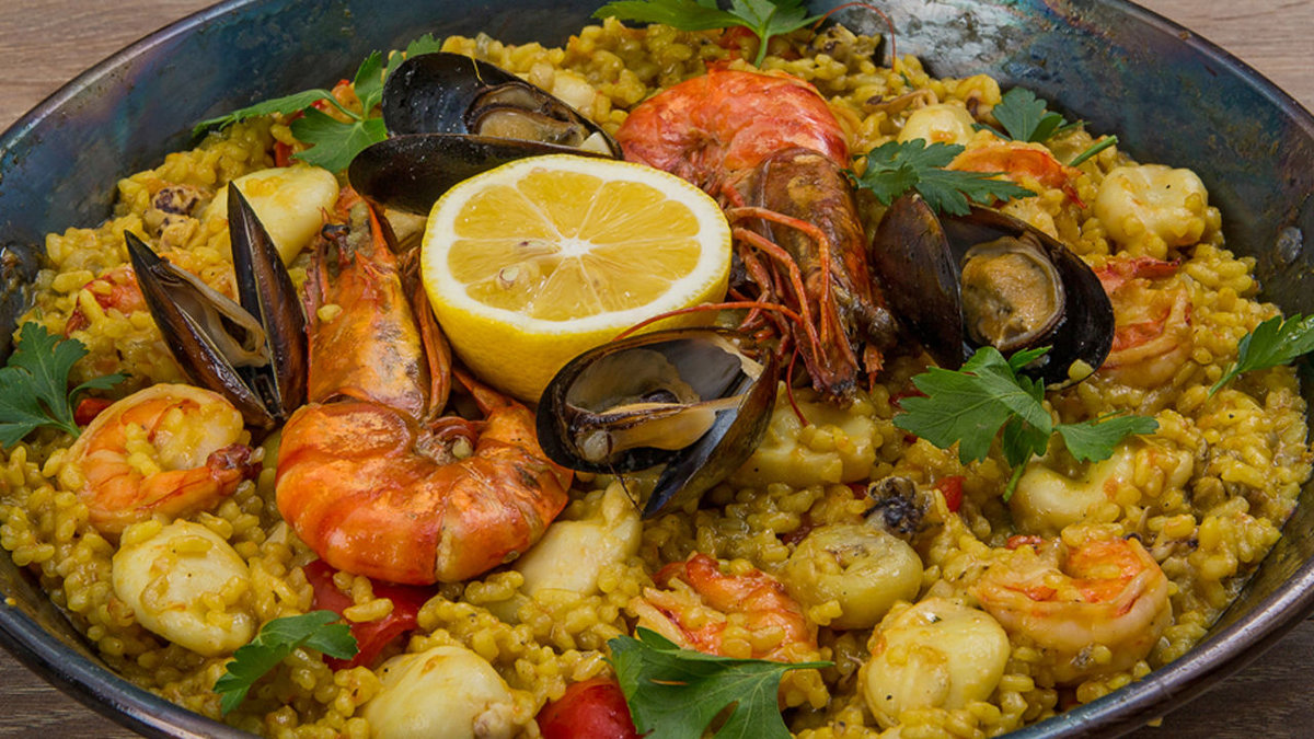paella Heat 1 tbsp olive oil in a large frying pan or wokadd 1 chopped onion and soften for 5 mins stir in 1 tsp hot smoked paprika, 1 tsp dried thyme and 300g paella or risotto rice, stir for 1 min, then splash in 3 tbsp sherry or white wine, if using.
