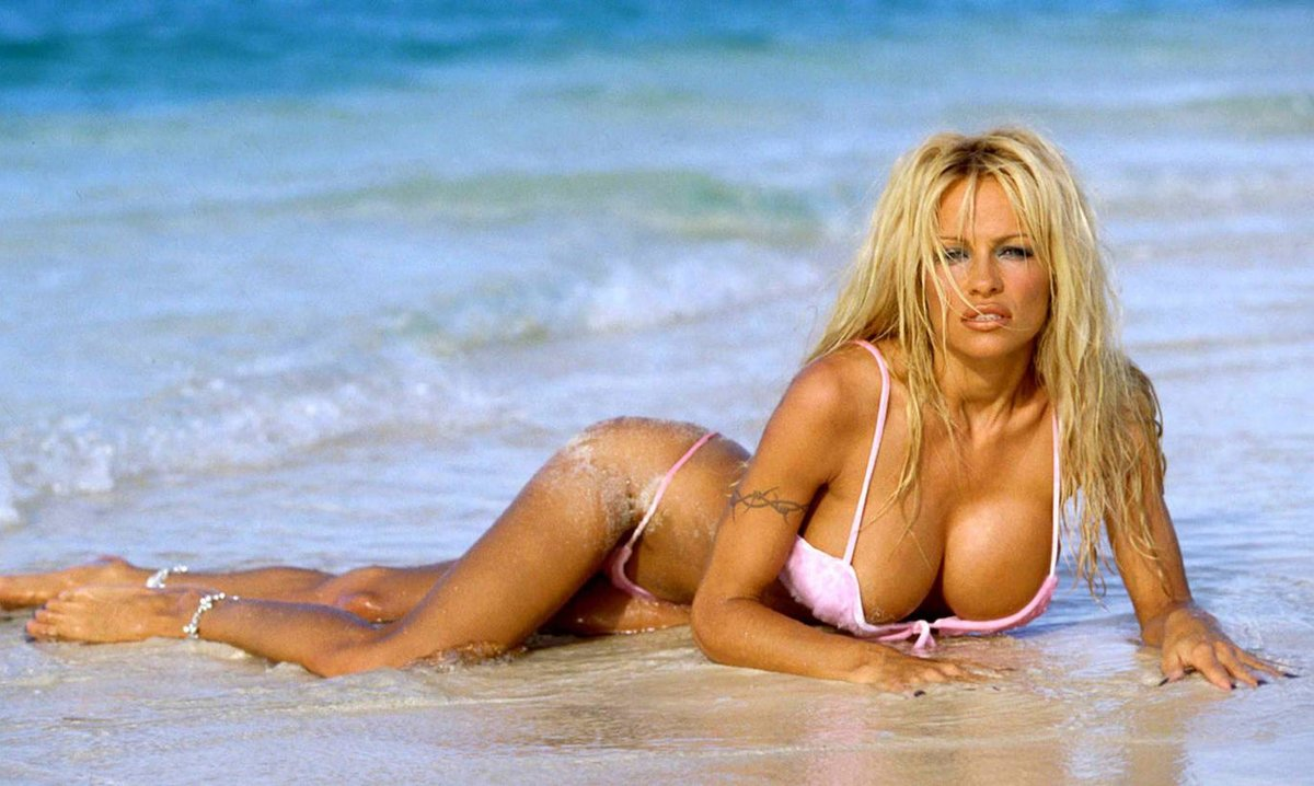 Pam anderson at topless beach — photo 2