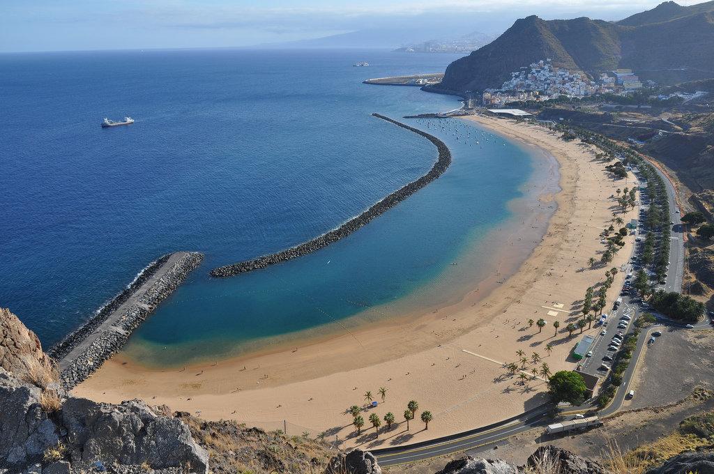 зима пляжи тенерифе с белым песком фото половина населения мира