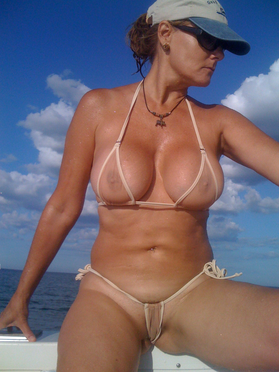Micro string bikini mom on boat — photo 13