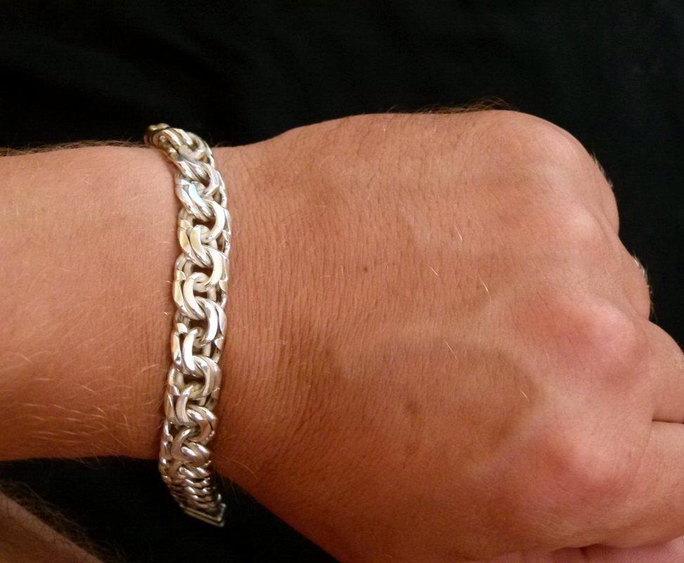 Мужской золотой браслет на руку тирпиц фото