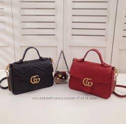 Реплика cумки Gucci в Новоржеве. Купить качественные люксовые копии  брендовых сумок оптом Купить со скидкой 6d2dca4fe5e