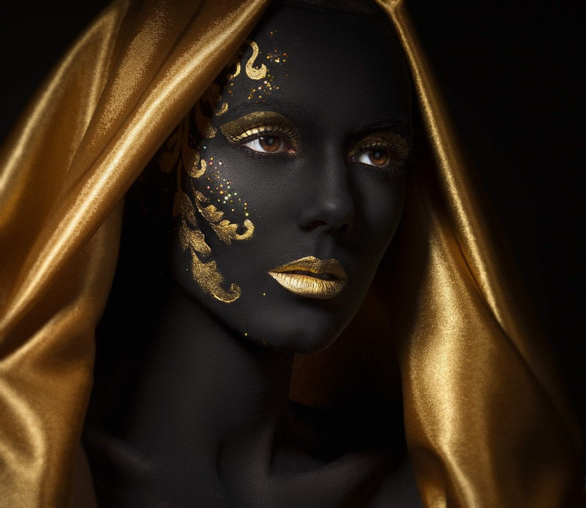 human arms painted gold