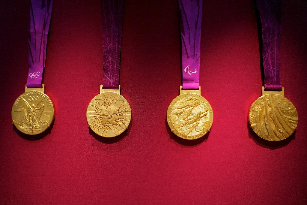 организовал медали олимпийских игр фото момента