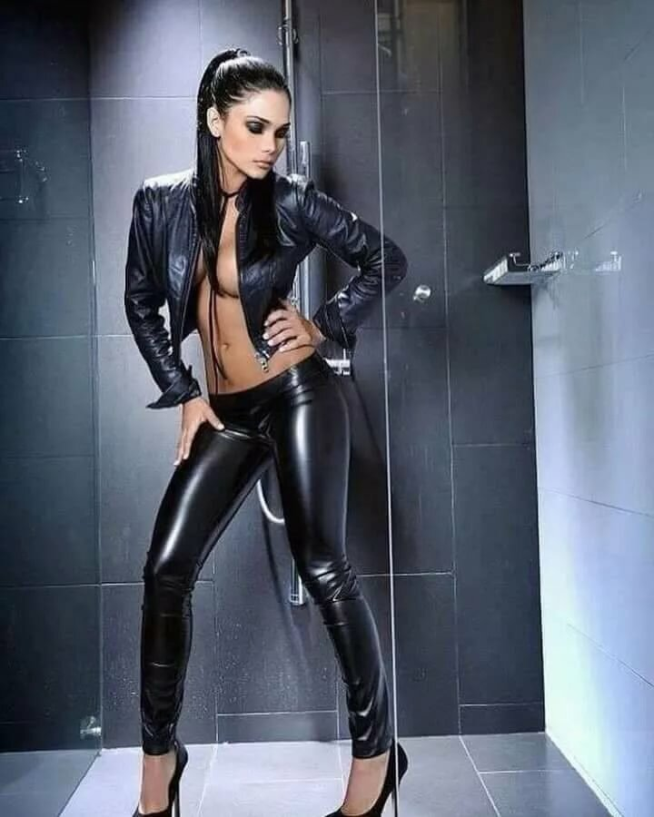 Naked woman in leather jacket stock image