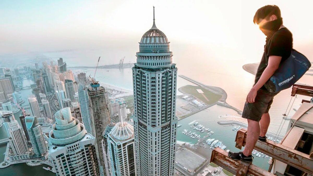 Картинки человек на высоких зданиях