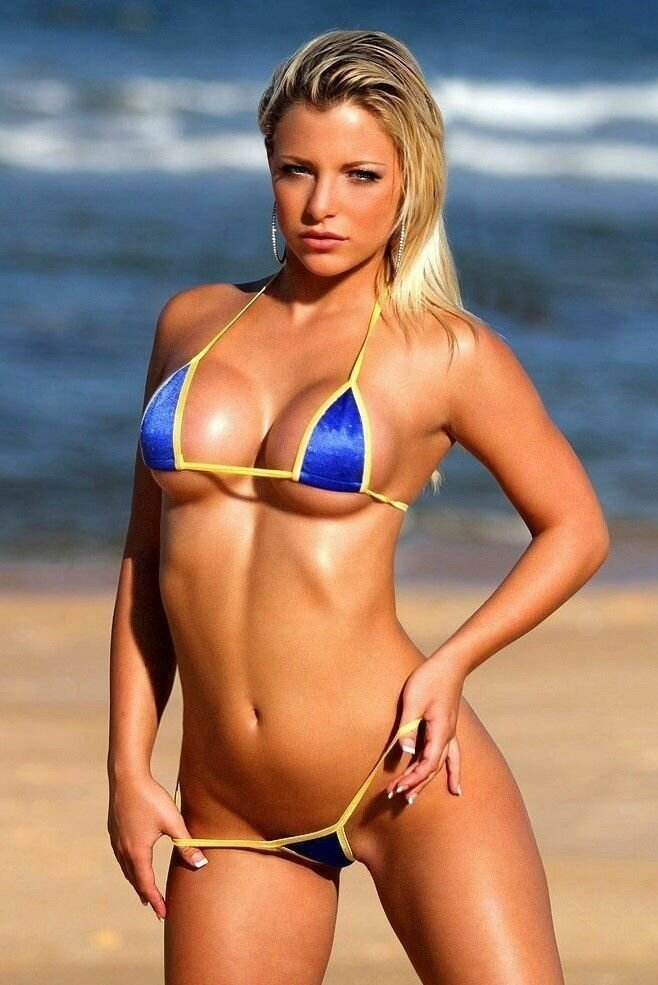 Blonde bikini girl in of pic string