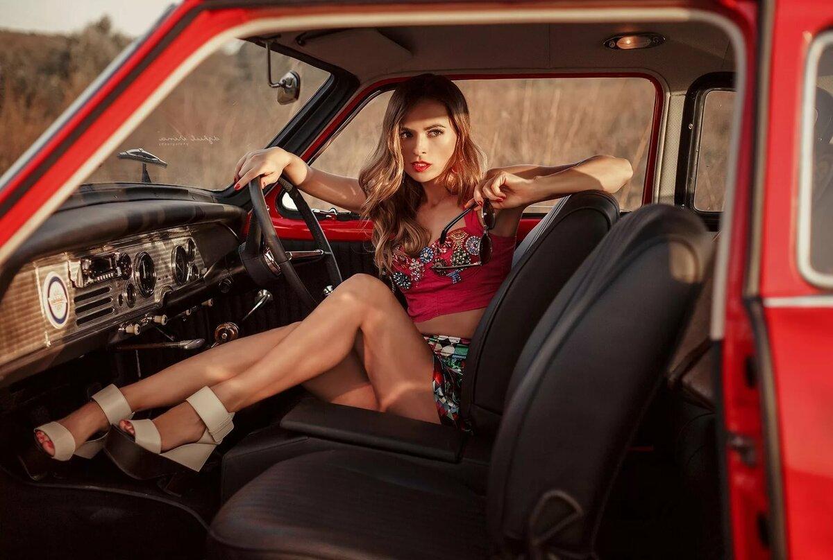 women-posing-on-cars