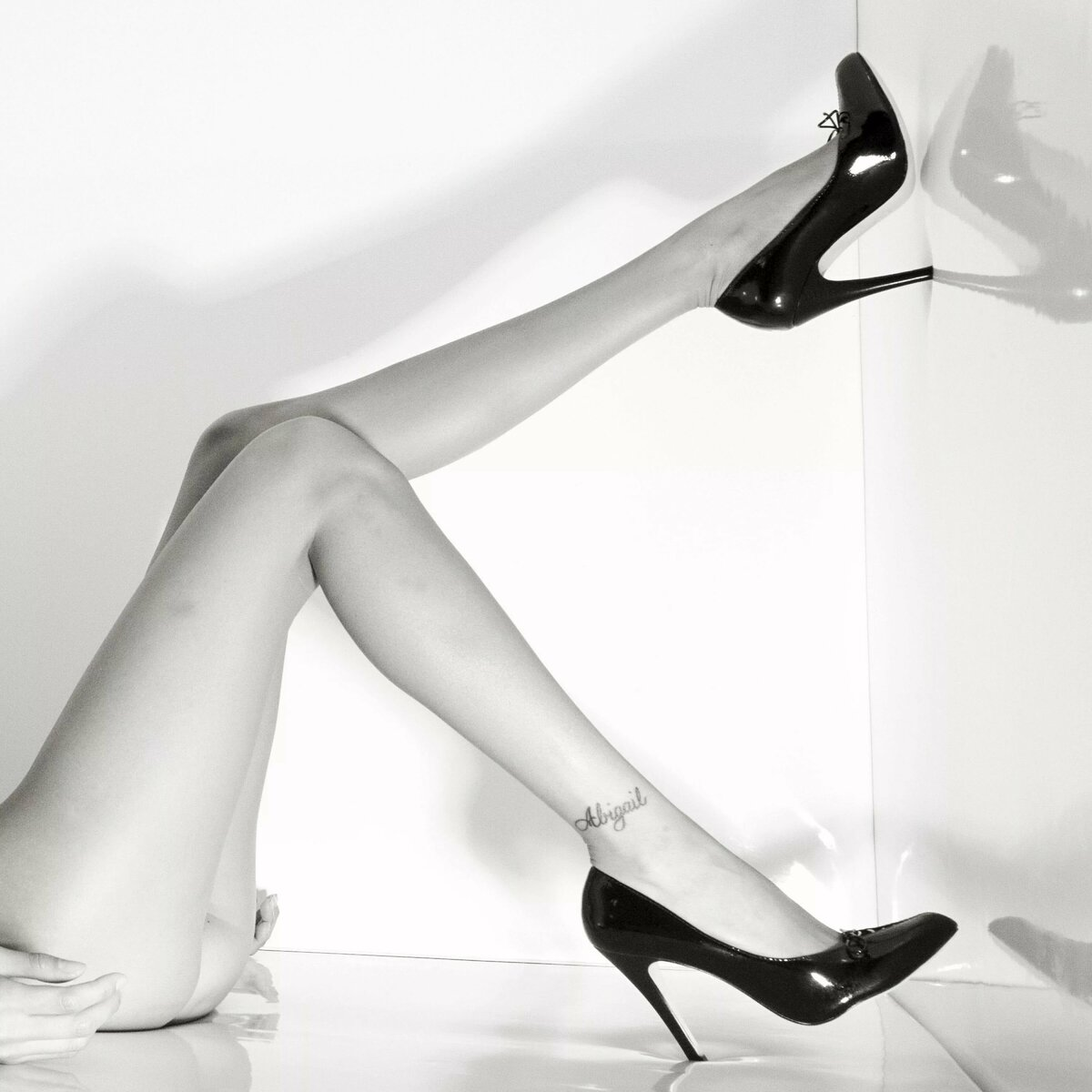 Photo of female erotic legs in shoes