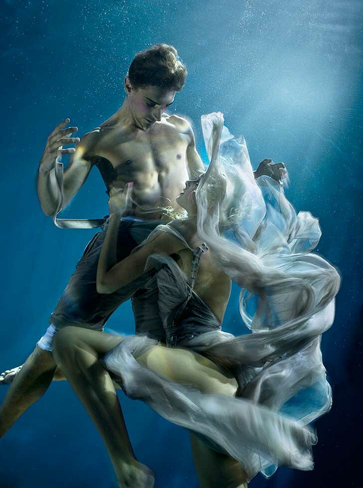 Siren charms, seductive chiffon and a single sailor create a photographic underwater fashion editorial commissioned by the FT Magazine
