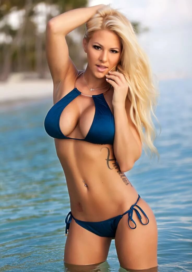 Blonde babe in a bikinis in general public