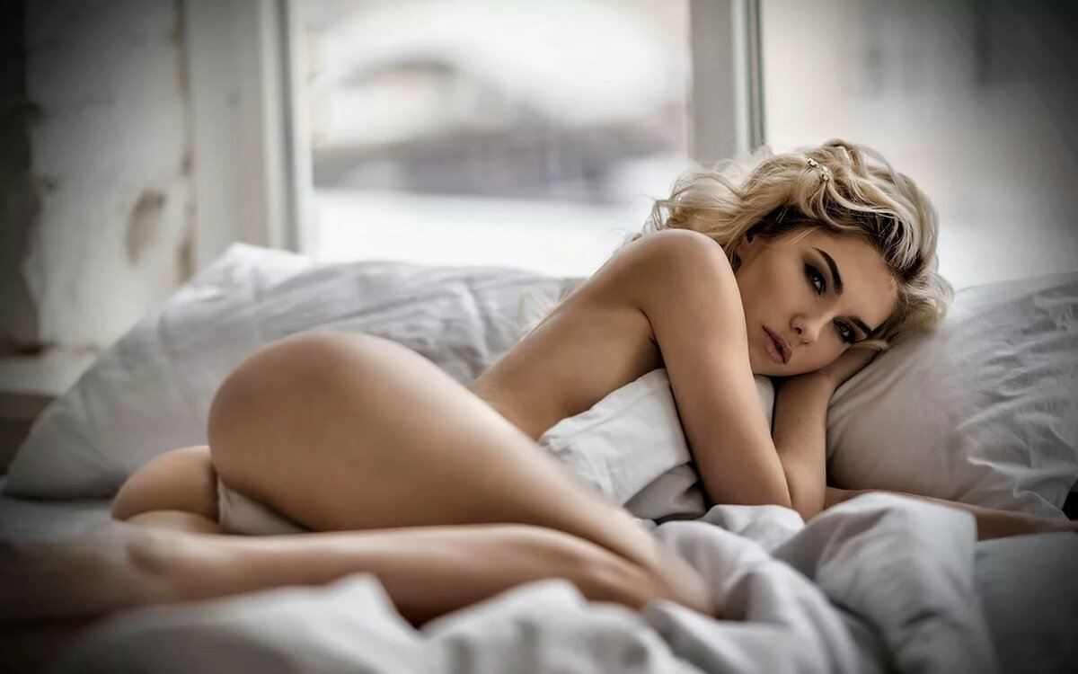 Nude females in bed