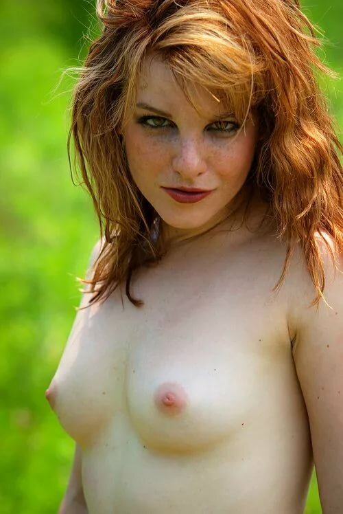 Freckled redhead woman naked