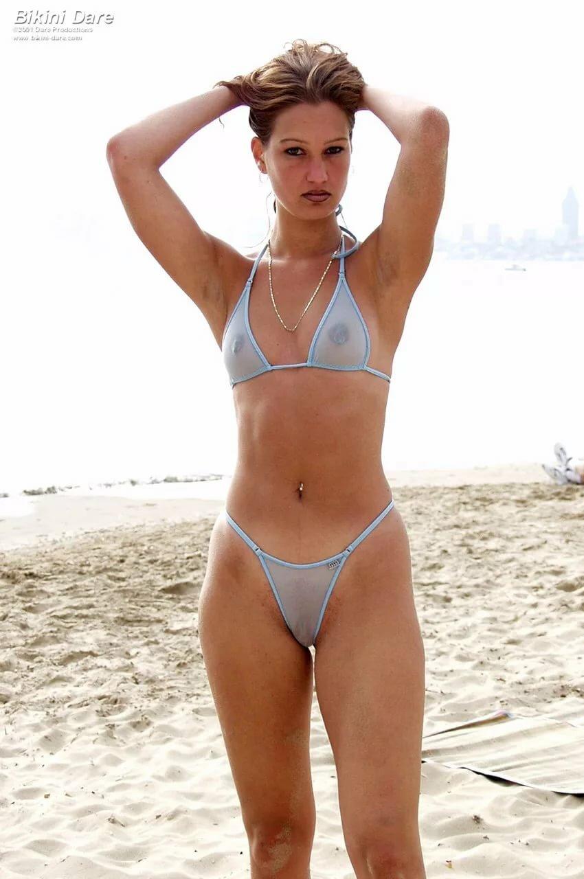 Tattooed see through bikinis young girls at beach sister