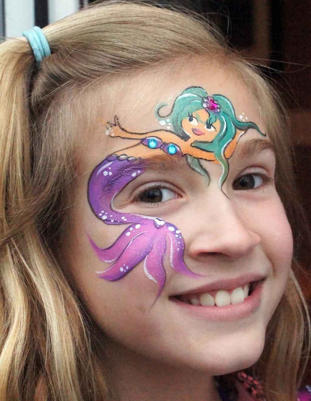 Mermaid Video Watch how to do this face paint idea 1 Sponge blue face paint over the eyes and up onto the forehead 2 With a brush paint a white