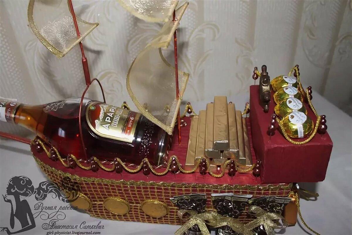 Бутылка коньяка на корабле фото