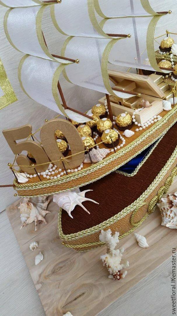 украшения космополитена лодка из конфет фото родине него репутация