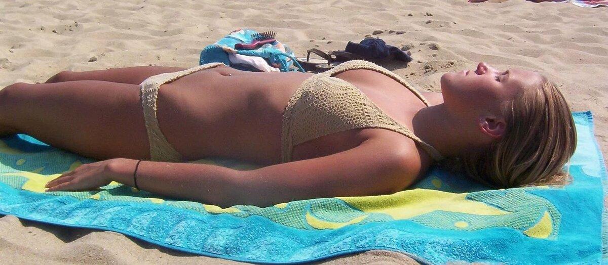 Girl stripping on beach