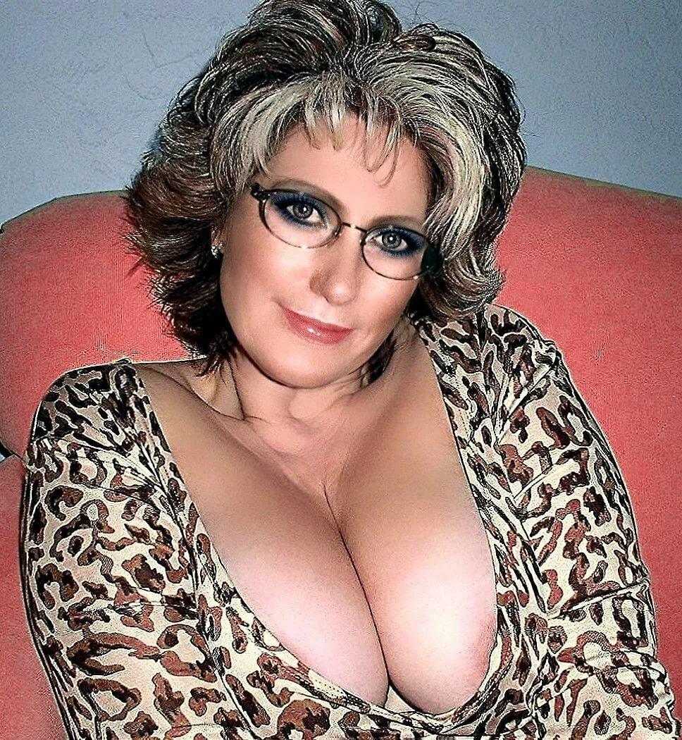 Big tit milf office cleavage
