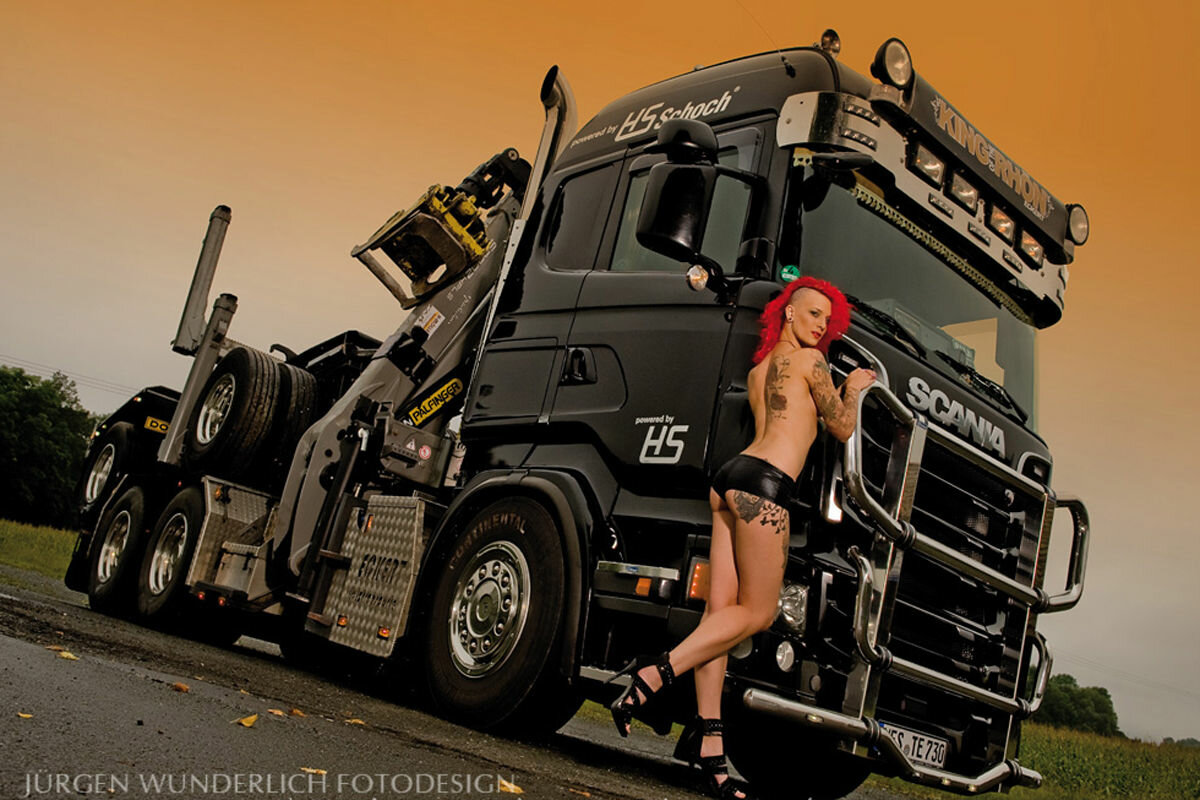 Naked woman with a big rig truck