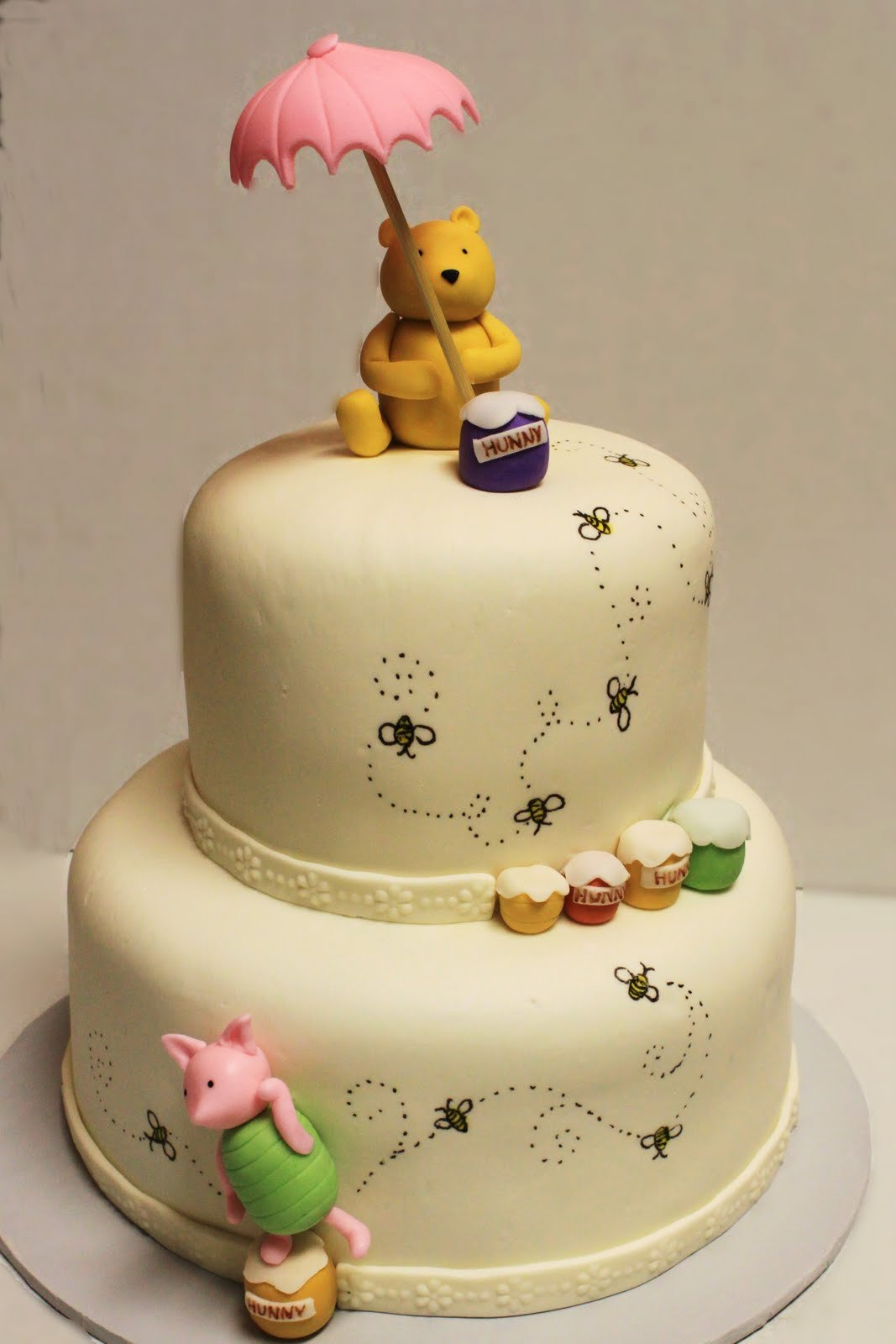 pooh cake Winnie the pooh lovers, unite a new set of adorable winnie the pooh cake toppers for baby showers and birthdays are now available featuring everyone's favorite huggable bear and his friends, you'll find a variety of playful and cute toppers for the perfect winnie the pooh cake.