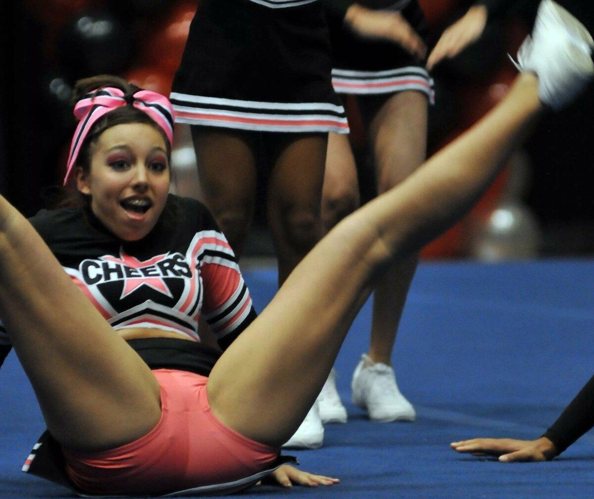 Teen cheerleaders leg lifts