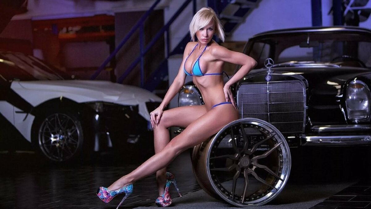 Sexy girl in garage wallpaper
