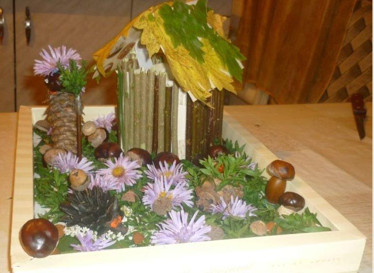 Поделка из шишек желудей и листьев на тему осень