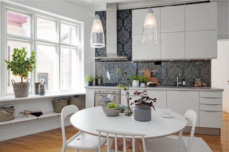 Какие растения нужно выращивать на кухне с пластиковой мебелью и ламинатом? Какой вид лучше держать подальше от детей? Где поставить герань и орхидею? Отвечаем на эти и другие вопросы, определяем идеальные комнатные растения и цветы и вдохновляемся их фото в интерьерах кухонь.