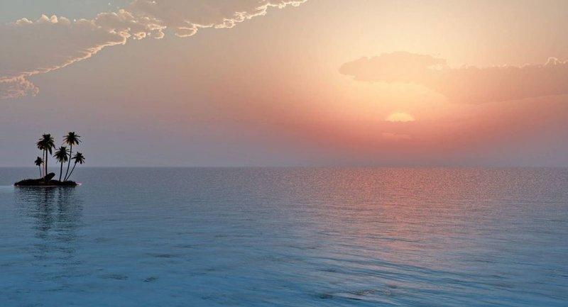 Маленький островок в море на фоне рассвета.