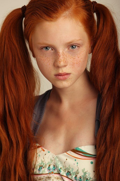 Portrait of a teenage girl with red hair blue eyes and lots of stock photo