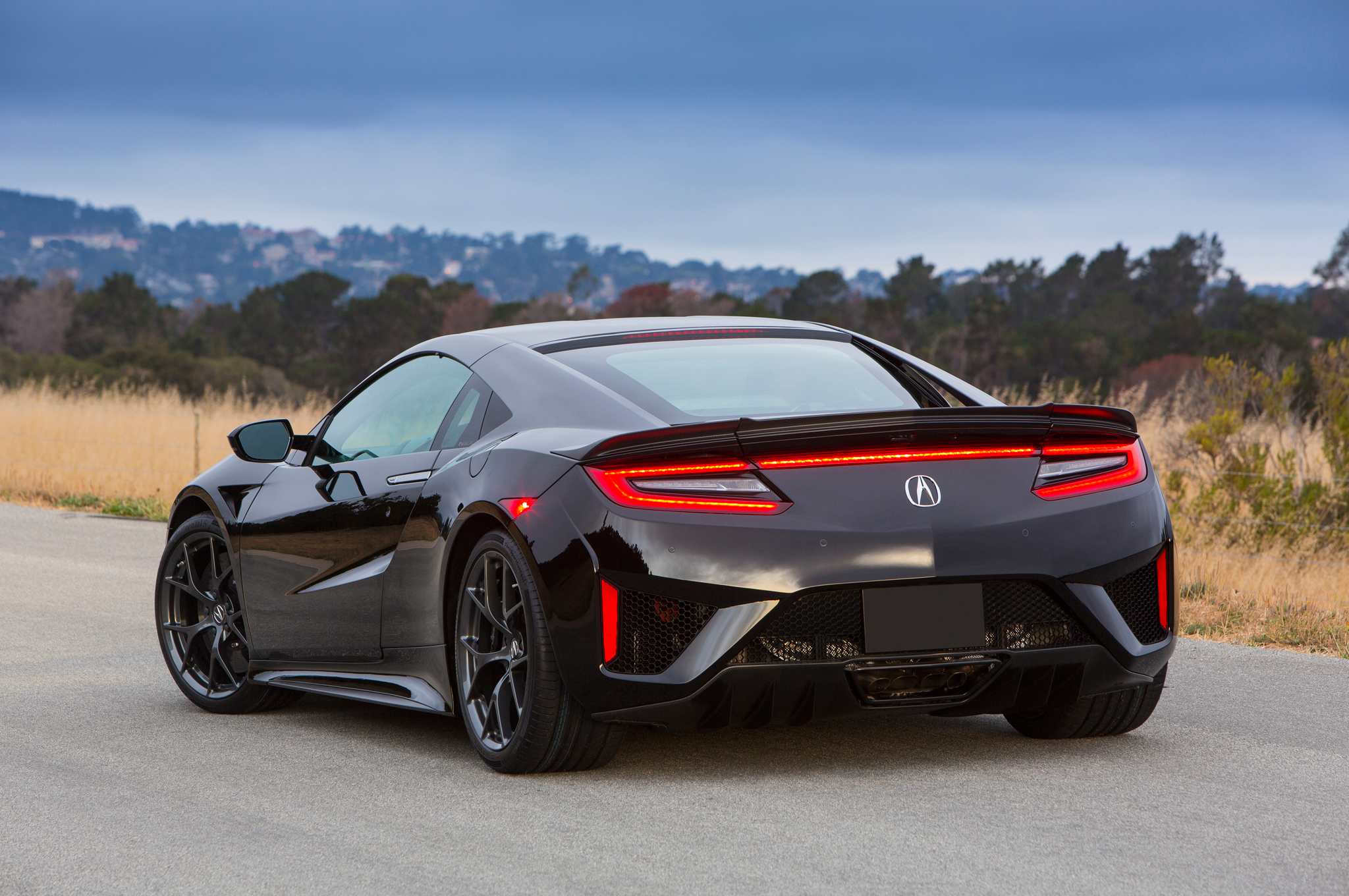 Honda Sports Car Ceo Says We Shouldnt Expect Any New Cars 421 2017 Acura Nsx At The Quail Rear End 02 Jpg