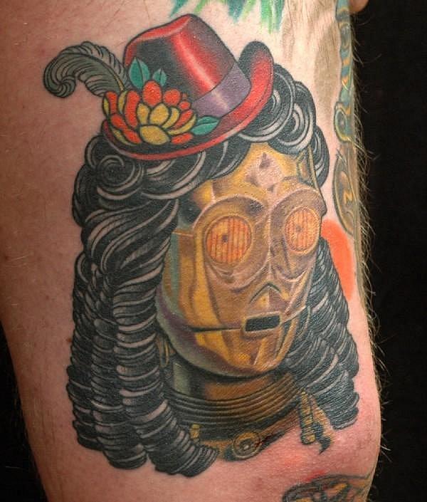 Золотой робот с париком