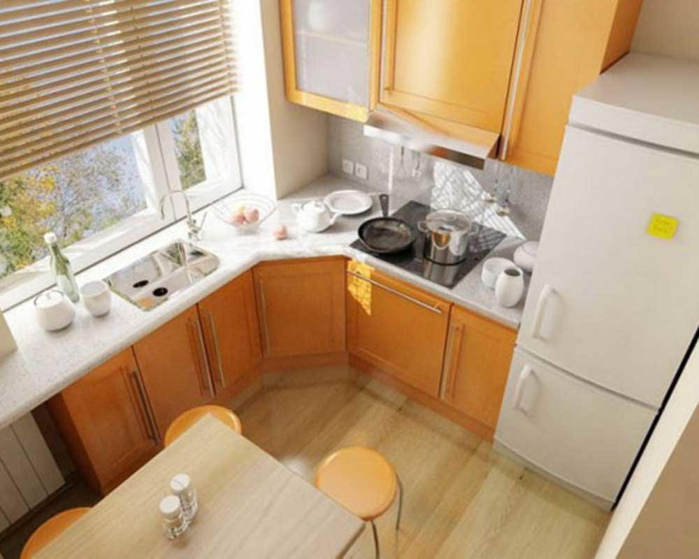Вместо стульев в интерьере малогабаритной кухни лучше исполь.
