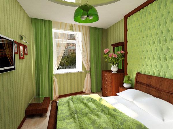"""маленького размера спальня в зеленых тонах  с """"мягкой"""" стеной за изголовьем кровати"""