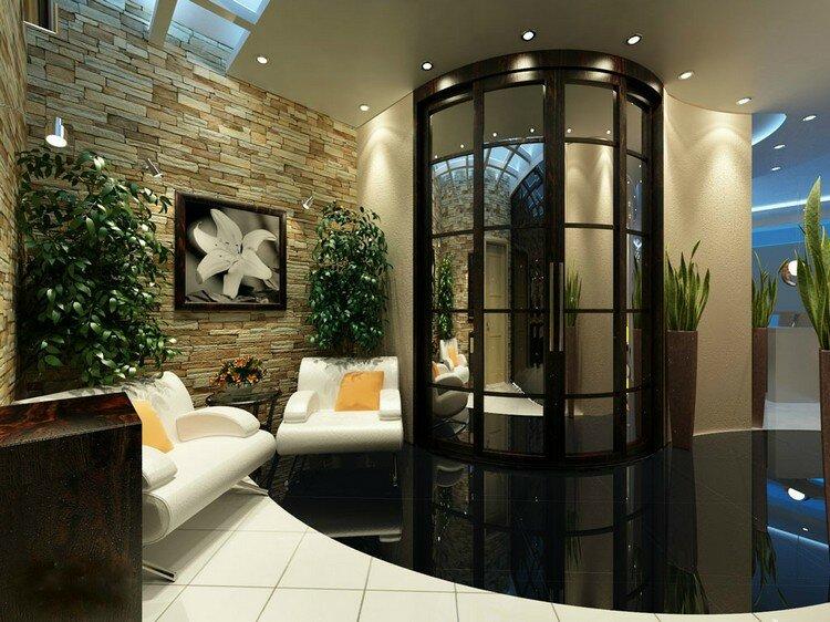 Живые комнатные растения гармонично смотрятся на фоне натуральных материалов, например, это может быть камень
