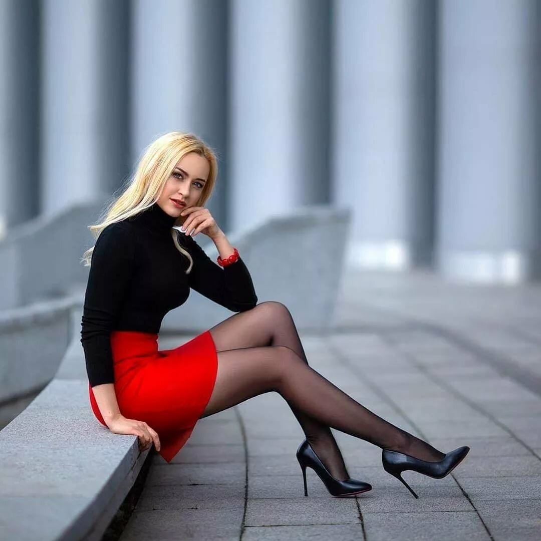 Beautiful blonde girl in black and brown dress stock photo