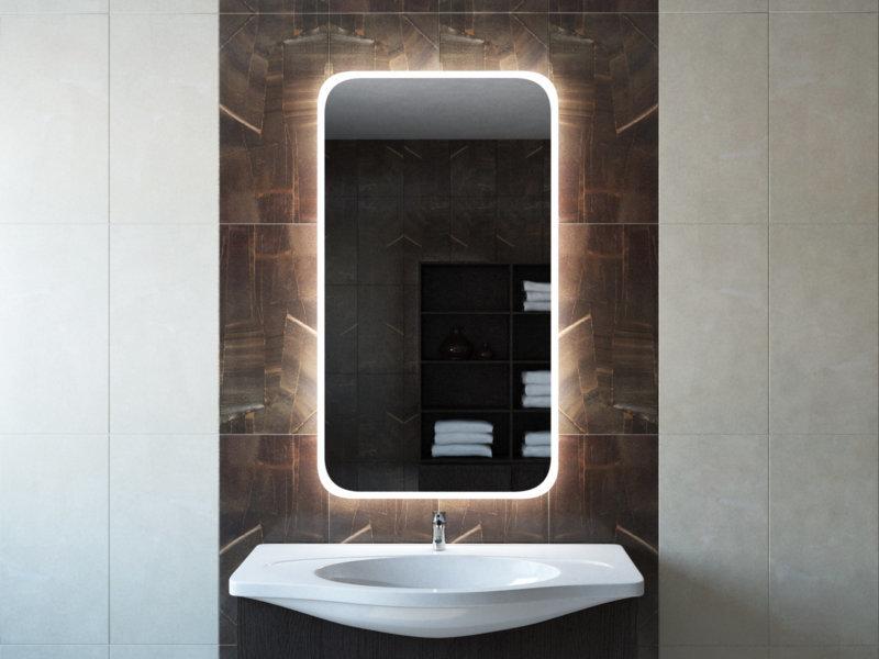 Зеркало со сглаженными углами на коричневой стене