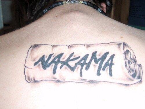 Свернутое полотенце с надписью Nakama