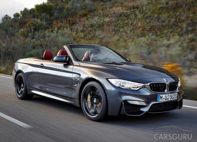 Автомобиль BMW M4 Convertible на фоне гор