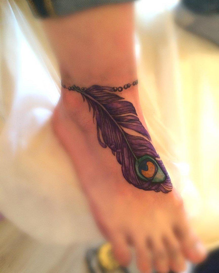 фото татуировок перо для человека лесной