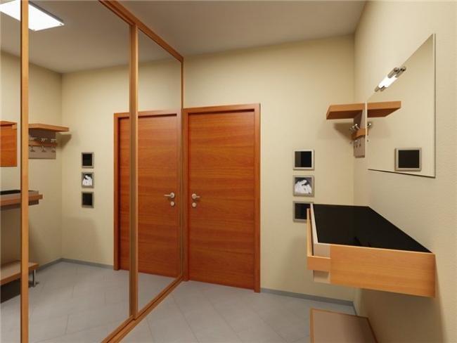 Сделать коридор шире и просторнее можно при помощи зеркал. Для этого они должны иметь достаточно внушительные размеры, и находиться на боковых стенах коридора. Неплохой вариант: зеркальные дверцы шкафов-купе, размещенных в коридоре. Здесь мы «убиваем сразу двух зайцев»: и помещение визуально увеличиваем, и получаем дополнительные места для хранения. Однако для того, чтобы расширить узкий коридор, при этом не загружая его мебелью достаточно на второй стороне стены разместить большое зеркало.