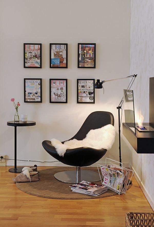 картины на стене и шкура животного в кресле служат декором данного кабинета