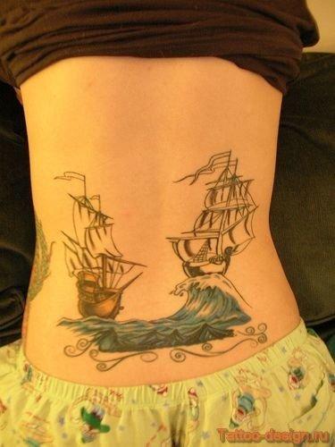 Фото татуировок на пояснице у девушек