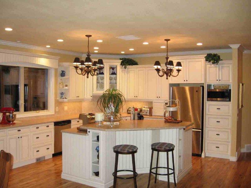 Дизайн кухни угловые с окном 24
