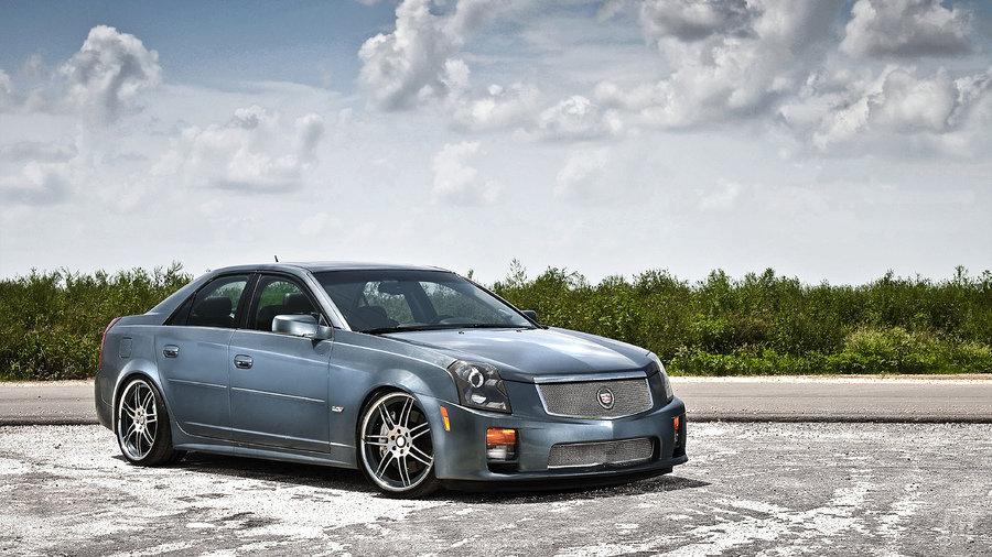 Cadillac в сером кузове
