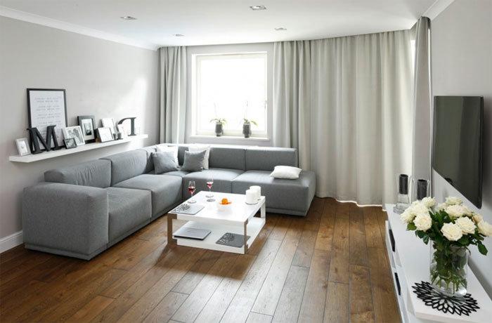 угловой диван в гостиной в интерьере фото
